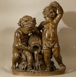 Two-putti-drinking-to-a-fountain-in-antique-urn-Terra-cotta-sculpture